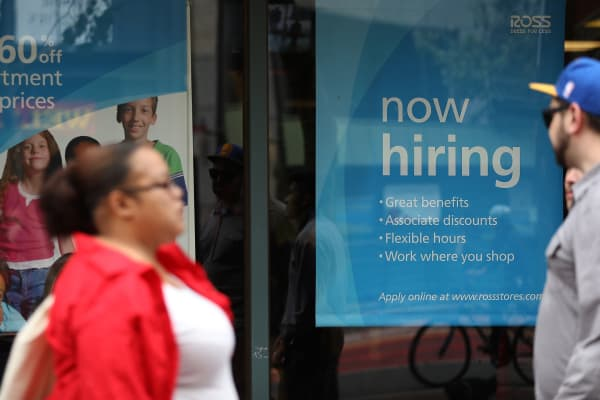 A 'now hiring' sign is posted outside of a Ross Dress for Less store in San Francisco.