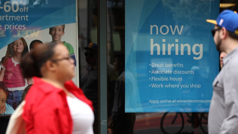 """A """"now hiring"""" sign is posted outside a store in San Francisco."""