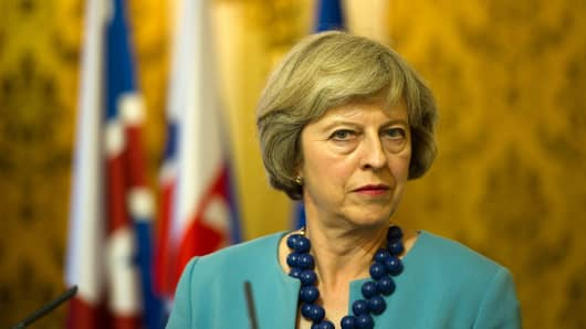 British Prime Minister Theresa May listens to journalists questions during a press conference.