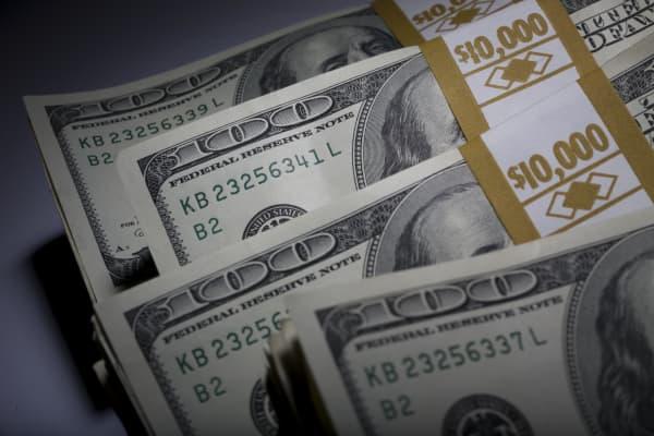 Money stacks $100 bills