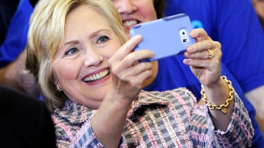 "Democratic presidential candidate Hillary Clinton takes a ""selfie"" with a supporter after a campaign rally at the Omaha North High Magnet School in Omaha, Nebraska August 1, 2016."