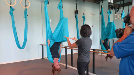 CNBC's Diana Olick doing aerial yoga.