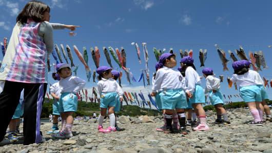 Kindergarten children at a riverside park in Sagamihara, Kanagawa prefecture.