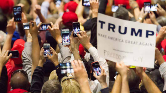 Supporters of republican presidential candidate Donald Trump take photos with phones at a rally at the Connecticut Convention Center on April 15, 2016 in Hartford, Connecticut.