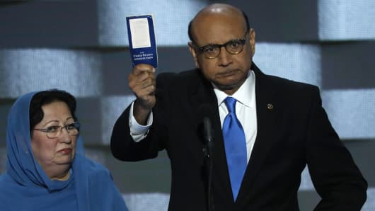 Khizr Khan, whose son, Humayun S. M. Khan was one of 14 American Muslims who died serving in the U.S. Army in the 10 years after the 9/11 attacks, offers to loan his copy of the Constitution to Republican U.S. presidential nominee Donald Trump, as he speaks while a relative looks on during the last night of the Democratic National Convention in Philadelphia, Pennsylvania, U.S. July 28, 2016.
