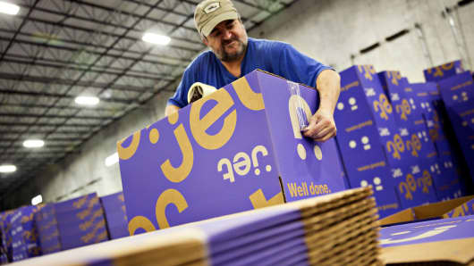 An employee prepares shipping boxes at the Jet.com fulfillment center in Kansas City, Kansas.