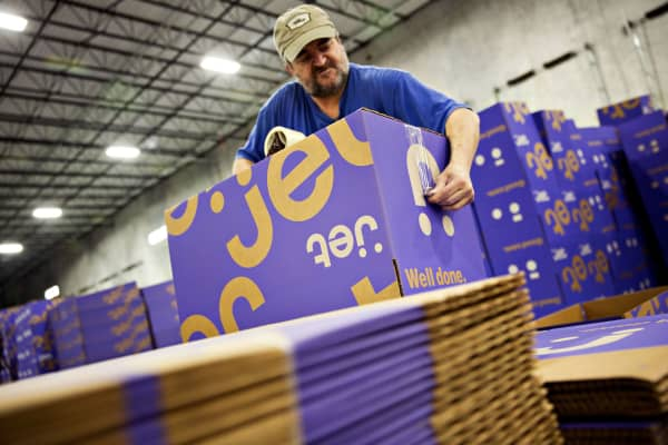 An employee prepares shipping boxes at the Jet.com fulfillment center in Kansas City, Kansas.