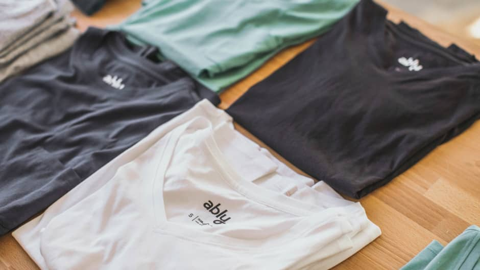 Ably shirts are made using a secret process that transforms natural fabric like cotton and silk into water-resistant clothing.