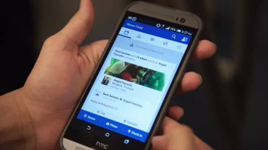 Facebook News Feed displayed on a smartphone