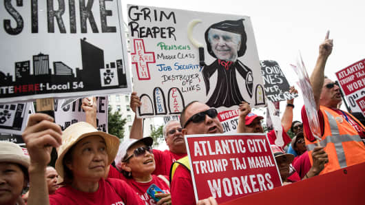 In this July 13, 2016 file photo, casino workers and activists protest outside Trump Taj Mahal owner Carl Icahn's office on Fifth Avenue in New York City.