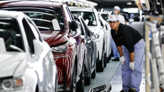 An employee inspects a Toyota Lexus NX sport-utility vehicle (SUV) on the production line at the Toyota plant in Miyawaka, Japan.