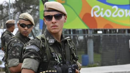 Brasilian soldiers stand guard near the Riocentro complex in Rio de Janeiro, on August 3, 2016, ahead of the Rio 2016 Olympic Games.