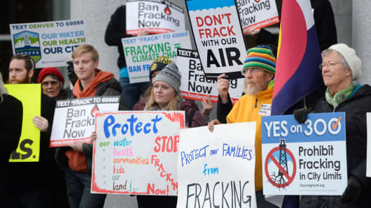 Protesters gathered out front of the Colorado Supreme Court Building to protest fracking before hearings on local communities and fracking on Wednesday, December 09, 2015.