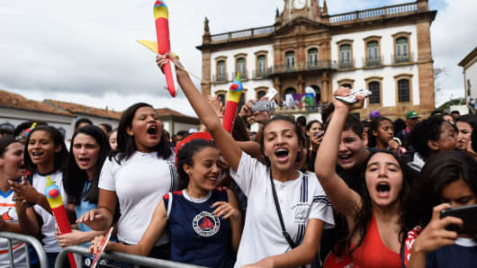Youngsters gather to celebrate the arrival of the Olympic torch at Tiradentes Square in Ouro Preto, Minas Gerais, Brazil last May.