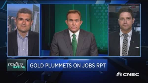 Gold slides on good jobs report