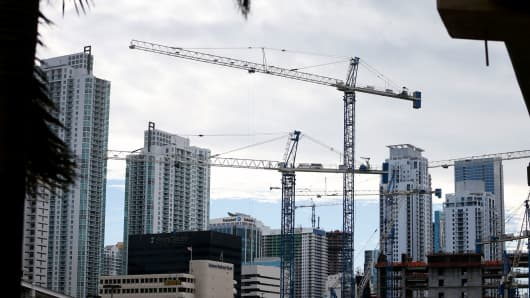 Cranes are seen against the skyline as condo's are built in Miami, Florida.