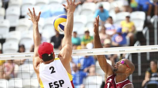 Adrian Gavira Collado (ESP) of Spain and Jefferson (QAT) of Qatar compete.