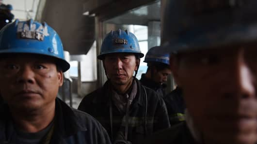 Miners wait to enter the Tashan coal mine near Datong, in northern Shanxi province.