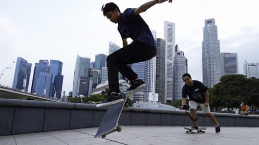 Youths skateboard in the central business district in Singapore.