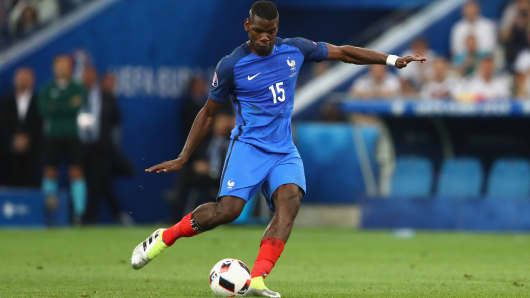 Paul Pogba of France runs with the ball during the UEFA EURO 2016 semi final match between Germany and France on July 7, 2016 in Marseille, France.