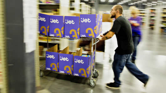 Employees collect items for customer orders at the Jet.com Inc. fulfillment center on Cyber Monday in Kansas City, Kansas, U.S., on Monday, Nov. 30, 2015.