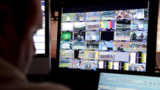 A Major League Baseball Advanced Media (BAM) employee monitors games that are being streamed live to pay subscribers at the BAM operations center in New York.