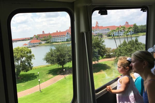 A mother and child look over the the Grand Floridian resort and Seven Seas Lagoon as they take the monorail around the Walt Disney World resort in Orlando, Florida.