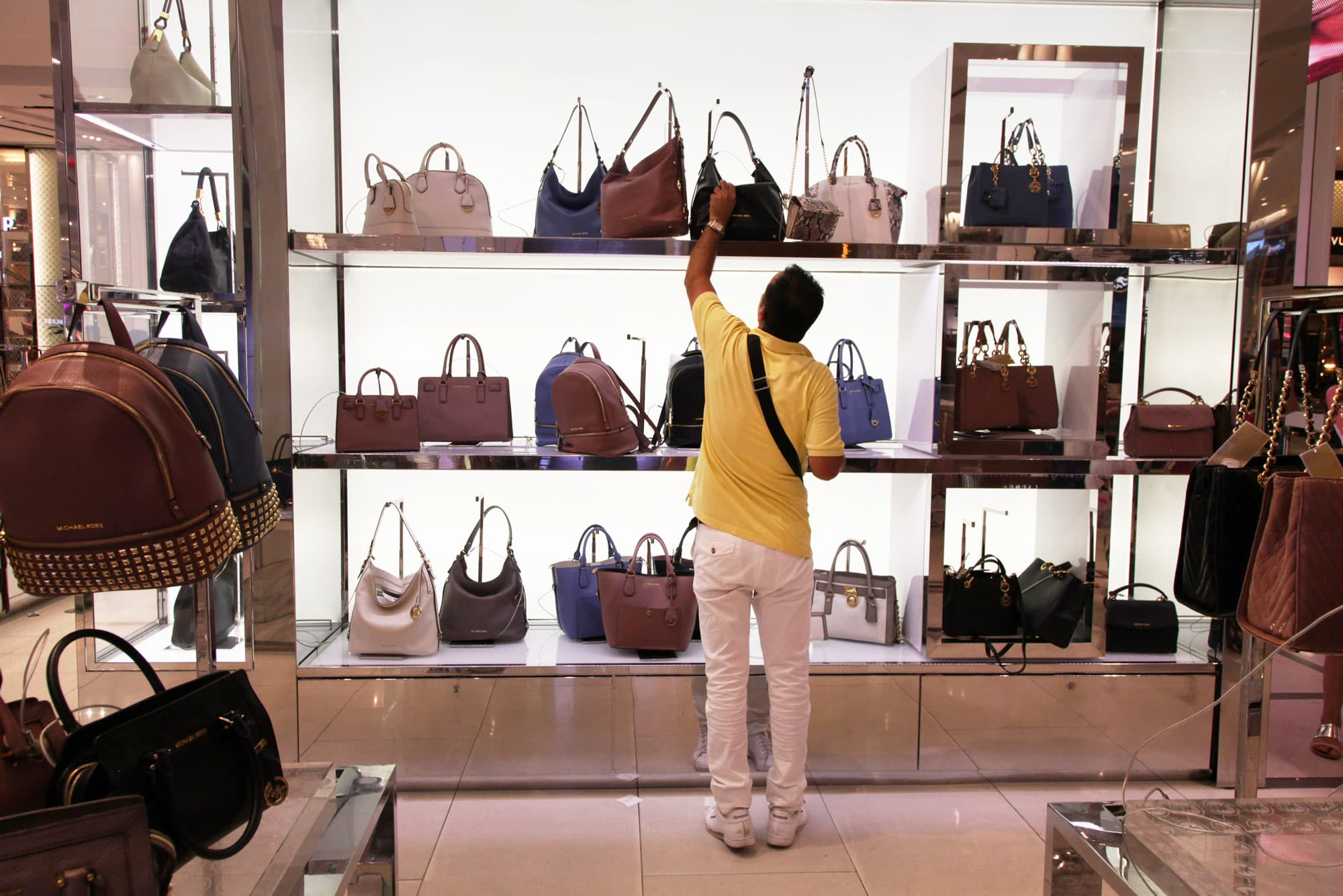 24b8e5e7064f Michael Kors is fed up with department stores damaging its brand