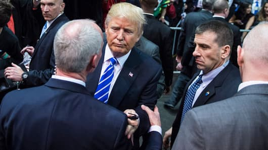 Republican presidential candidate Donald Trump with secret service men