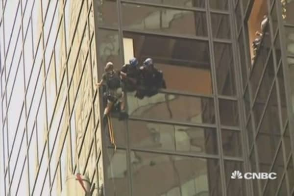 Climber pulled off Trump Tower mid climb