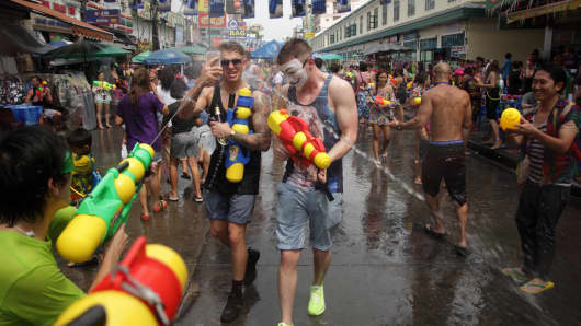 Foreign tourists take part in water battles to celebrate the Songkran Festival for the Thai New Year at Khao San road in Bangkok. The Songkran Festival runs from 13 to 15 April with people celebrating in various ways, including splashing water at each other for luck.