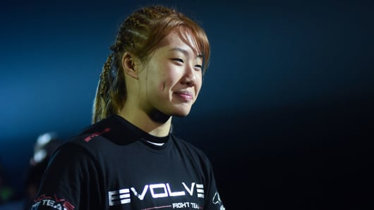 Singaporean mixed martial arts fighter Angela Lee enters the stadium during the ONE Championship Spirit of Champions held at the Mall of Asia Arena in Pasay City, south of Manila on December 11, 2015.