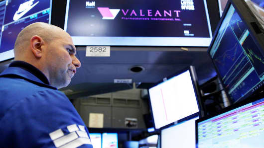 A specialist trader works at the post where Valeant Pharmaceuticals International is traded on the floor of the New York Stock Exchange.