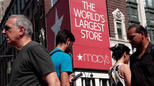 People walk past Macy's flagship store in Herald Square, August 11, 2016 in New York City.