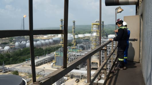 Employees speak on a balcony at the Refineria de Cartagena in Colombia on May 20, 2016.