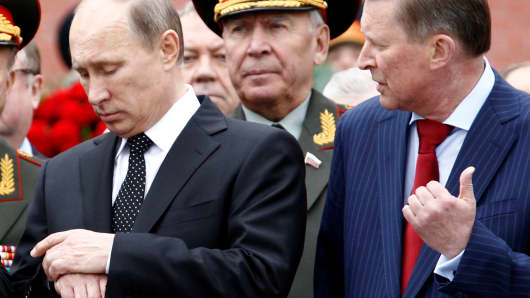 Russian President Vladimir Putin (L) and now former chief of President's staff Sergei Ivanov