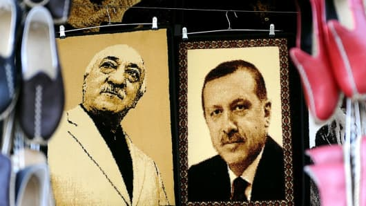 Embroidered images of United States-based Turkish cleric Fethullah Gulen (L) and Turkey's Prime Minister Recep Tayyip Erdogan (R) are displayed in a shop in the Gaziantep market on January 17, 2014 in Gaziantep, near the Turkish-Syrian border.