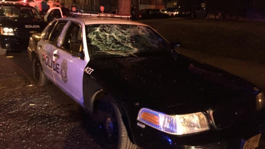 A police car with broken windows is seen in a photograph released by the Milwaukee Police Department after disturbances following the police shooting of a man in Milwaukee, Wisconsin, U.S. August 13, 2016.