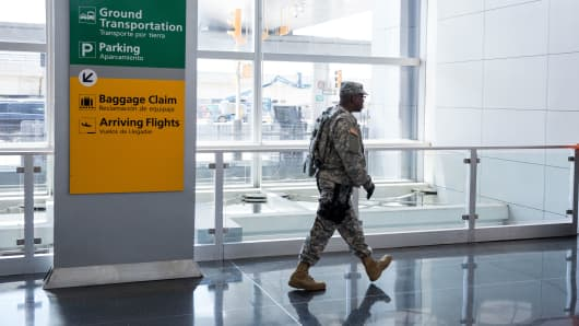 A member of the U.S. Army walks through John F. Kennedy International Airport, June 30, 2016.