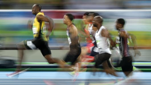 Jamaica's Usain Bolt (L) competes in the Men's 100m Semifinal during the athletics event at the Rio 2016 Olympic Games at the Olympic Stadium in Rio de Janeiro on August 14, 2016.