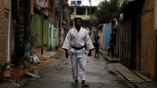 Popole Misenga, a refugee from the Democratic Republic of Congo and a judo athlete, poses for a photo near his home in a slum in Rio de Janeiro, Brazil, June 2, 2016.