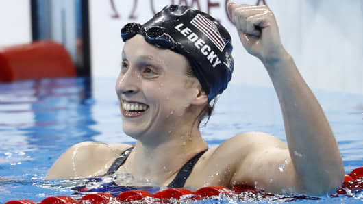 USA's Katie Ledecky celebrates after she broke the world record to win the Women's 800m Freestyle Final during the swimming event at the Rio 2016 Olympic Games at the Olympic Aquatics Stadium in Rio de Janeiro on August 12, 2016.
