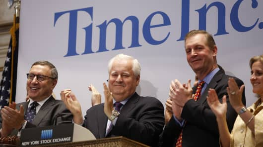 Time Inc. CEO Joe Ripp (2nd L) claps after ringing the bell to open trading at the New York Stock Exchange