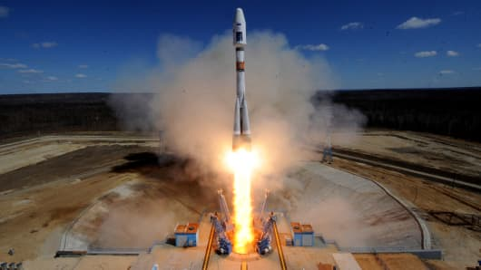 A Russian Soyuz 2.1a rocket carrying Lomonosov, Aist-2D and SamSat-218 satellites lifts off from the launch pad at the new Vostochny cosmodrome outside the city of Uglegorsk