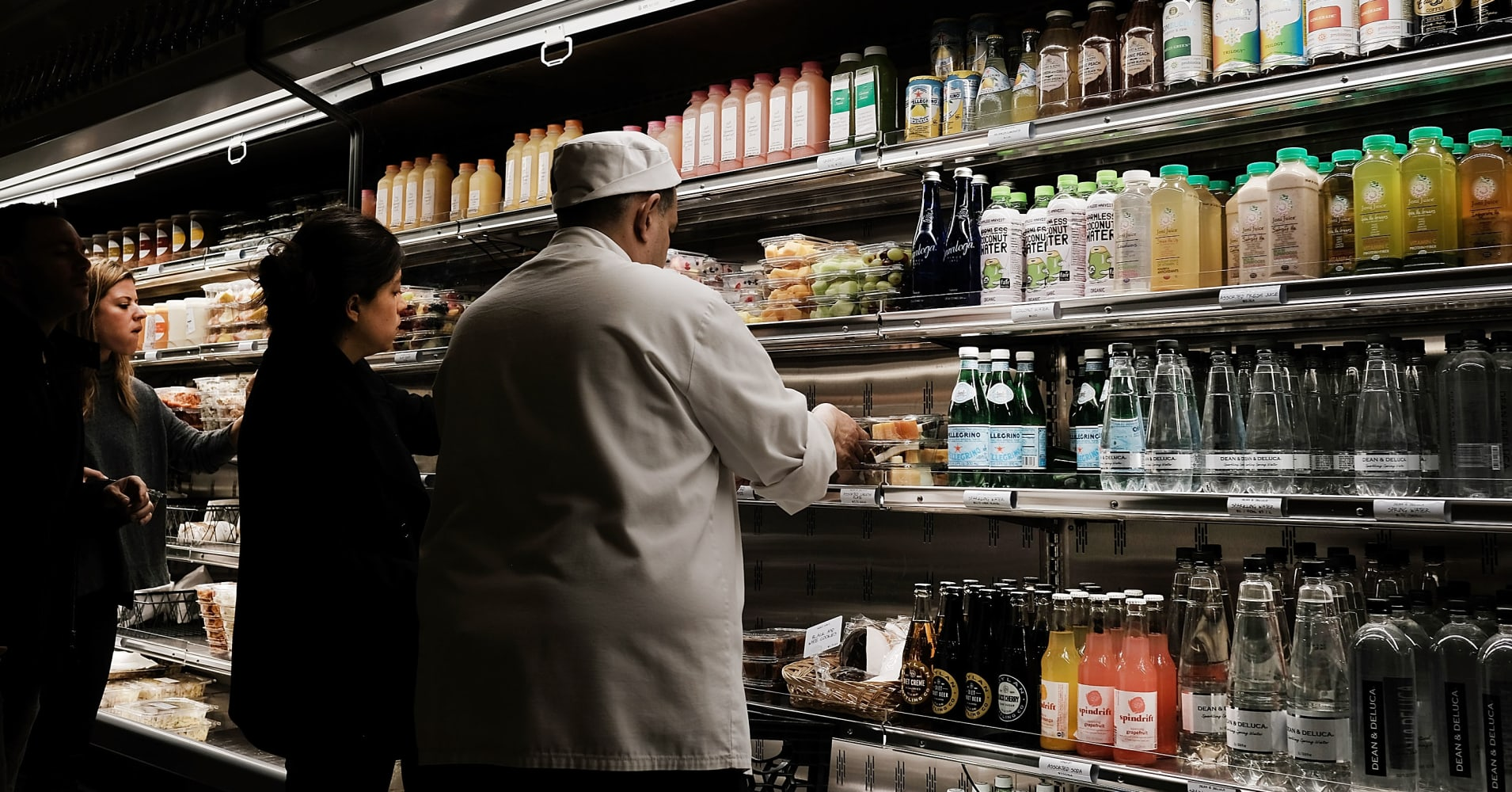 People shop in a Manhattan grocery store in New York, New York.