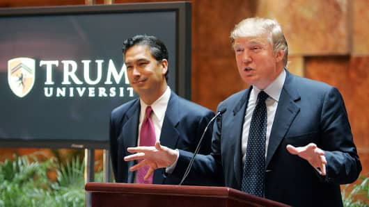Real estate mogul Donald Trump (R) speaks as university president Michael Sexton (L) looks on during a news conference announcing the establishment of Trump University May 23, 2005 in New York City.