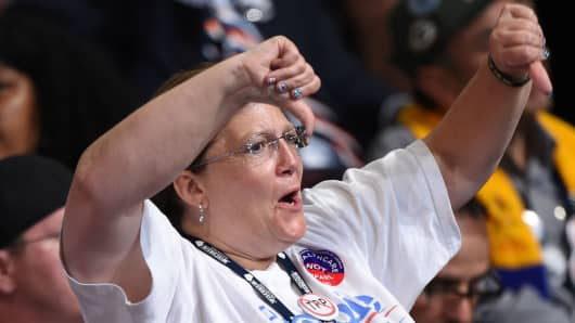 A supporter of former Democratic presidential candidate Bernie Sanders gives the thumbs down gesture as Hillary Clinton's name is mentioned during Day 1 of the Democratic National Convention at the Wells Fargo Center in Philadelphia, Pennsylvania, July 25,
