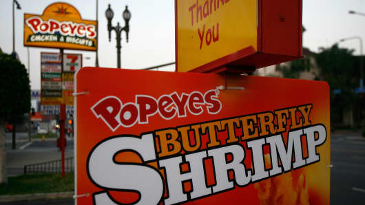 A sign for Popeyes fast-food restaurant hangs in the Figueroa Corridor area of South Los Angeles.