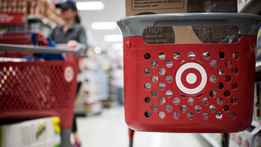 Customers use Target Corp. shopping carts to move products inside a company's store in Chicago, Illinois.