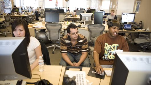 Employees at work in the Facebook headquarters, where the atmosphere is casual and laid-back, in Palo Alto.